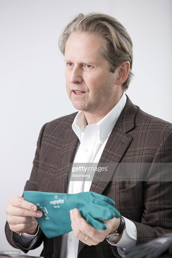 Magnus Nicolin, chief executive officer of Ansell Ltd., holds one of the company's gloves as he speaks during a Bloomberg interview in London, U.K., on Monday, Nov. 11, 2013. Ansel, an Australian maker of surgical gloves, also owns China's second-largest condom maker Wuhan Jissbon Sanitary Products Co. Photographer: Jason Alden/Bloomberg via Getty Images