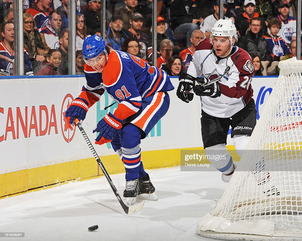 Magnus Paajarvi #91 of the Edmonton Oilers battles for the puck against <a gi-track='captionPersonalityLinkClicked' href=/galleries/search?phrase=Paul+Stastny&family=editorial&specificpeople=2494330 ng-click='$event.stopPropagation()'>Paul Stastny</a> #26 of the Colorado Avalanche during the NHL game at Rexall Place on February 16, 2013 in Edmonton, Alberta, Canada.
