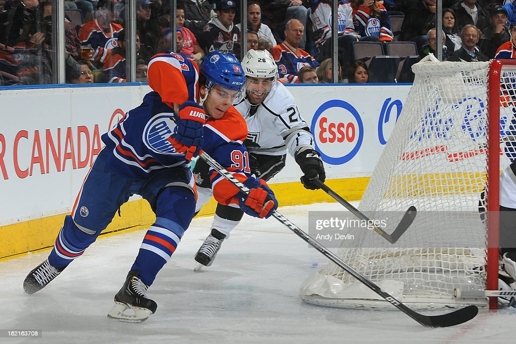 Magnus Paajarvi #91 of the Edmonton Oilers battles for the puck against <a gi-track='captionPersonalityLinkClicked' href=/galleries/search?phrase=Jarret+Stoll&family=editorial&specificpeople=204632 ng-click='$event.stopPropagation()'>Jarret Stoll</a> #28 the Los Angeles Kings on February 19, 2013 at Rexall Place in Edmonton, Alberta, Canada.