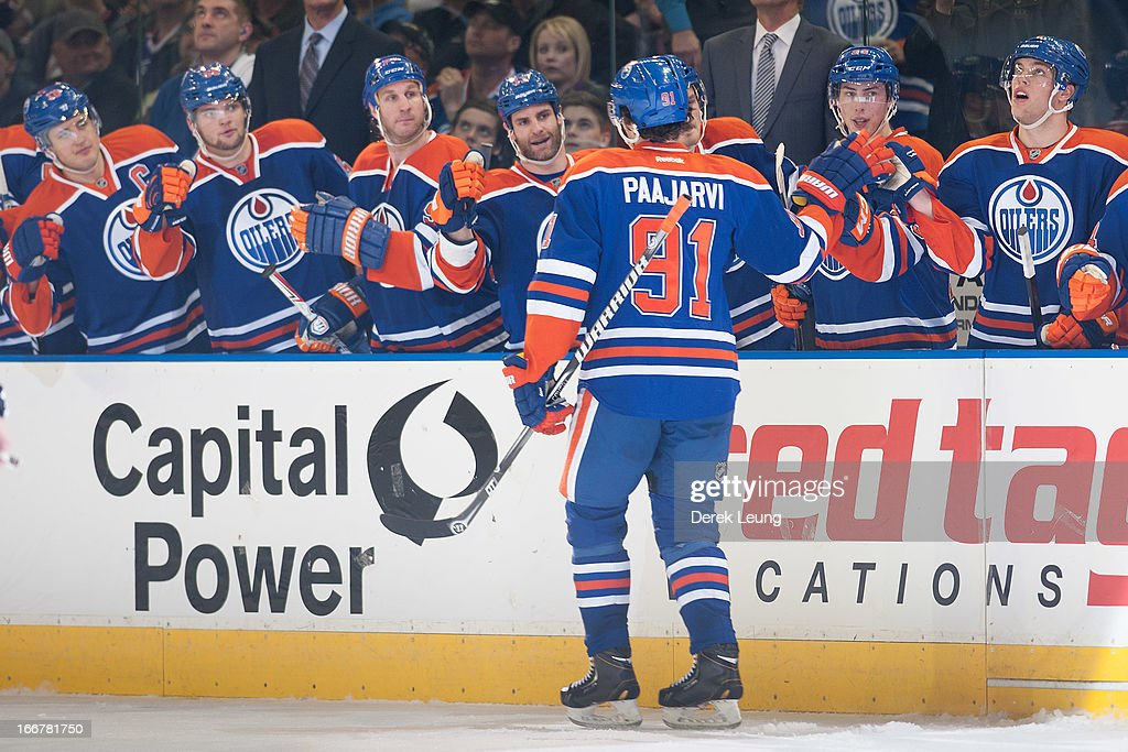 Magnus Paajarvi #91 of the Edmonton Oilers celebrates his third period goal against the Minnesota Wild during an NHL game at Rexall Place on April 16, 2013 in Edmonton, Alberta, Canada.