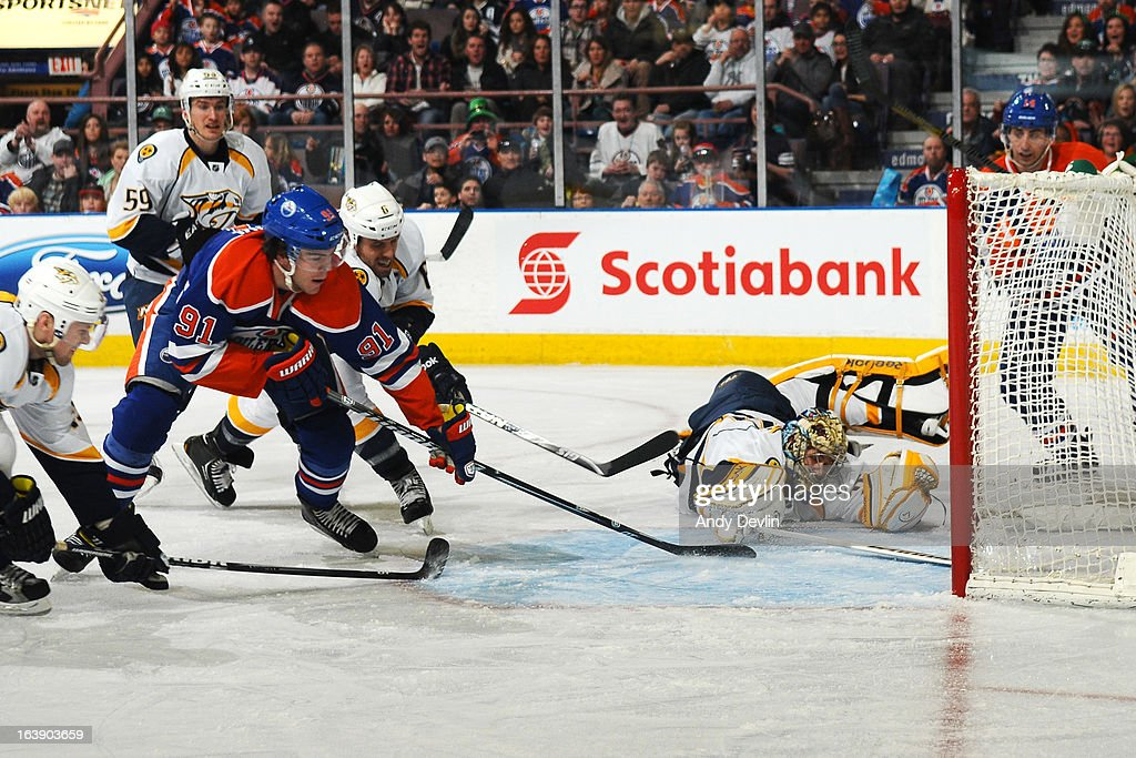 Magnus Paajarvi #91 of the Edmonton Oilers scores a second period goal on <a gi-track='captionPersonalityLinkClicked' href=/galleries/search?phrase=Pekka+Rinne&family=editorial&specificpeople=2118342 ng-click='$event.stopPropagation()'>Pekka Rinne</a> #35 of the Nashville Predators on March 17, 2013 at Rexall Place in Edmonton, Alberta, Canada.