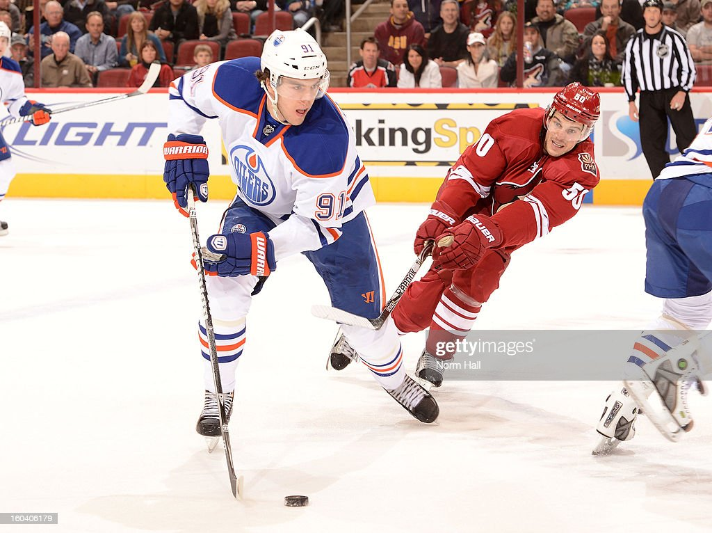 Magnus Paajarvi #91 of the Edmonton Oilers skates past <a gi-track='captionPersonalityLinkClicked' href=/galleries/search?phrase=Antoine+Vermette&family=editorial&specificpeople=206302 ng-click='$event.stopPropagation()'>Antoine Vermette</a> #50 of the Phoenix Coyotes with the puck at Jobing.com Arena on January 30, 2013 in Glendale, Arizona.