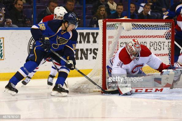 Magnus Paajarvi of the St Louis Blues attempts to score a goal against Carey Price of the Montreal Canadiens at the Scottrade Center on December 19...