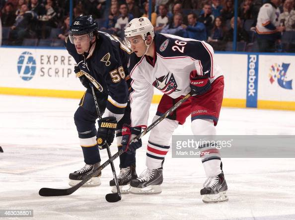 Magnus Paajarvi of the St Louis Blues faces off against Corey Tropp of the Columbus Blue Jackets during an NHL game on January 4 2014 at Scottrade...