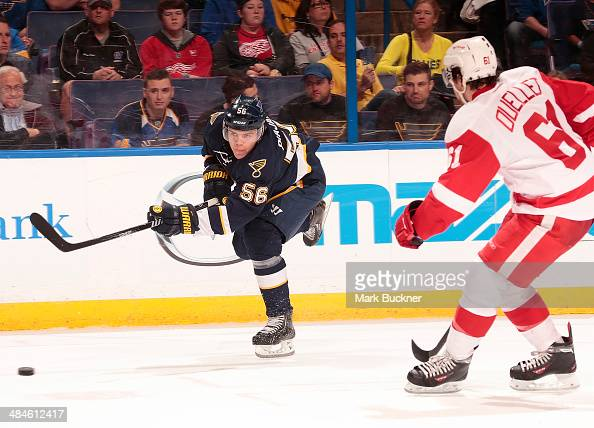 Magnus Paajarvi of the St Louis Blues fires the puck past Xavier Ouellet of the Detroit Red Wings of the Detroit Red Wings during an NHL game on...