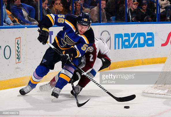 Magnus Paajarvi of the St Louis Blues handles the puck as Nick Holden of the Colorado Avalanche defends on November 1 2014 at Scottrade Center in St...