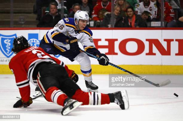 Magnus Paajarvi of the St Louis Blues shoots and scores a goal over Duncan Keith of the Chicago Blackhawks in the first period at the United Center...