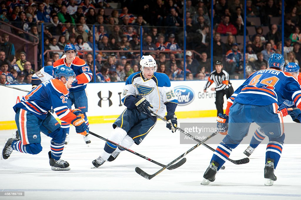 Magnus Paajarvi #56 of the St. Louis Blues skates with the puck against <a gi-track='captionPersonalityLinkClicked' href=/galleries/search?phrase=Andrew+Ference&family=editorial&specificpeople=202264 ng-click='$event.stopPropagation()'>Andrew Ference</a> #21 and <a gi-track='captionPersonalityLinkClicked' href=/galleries/search?phrase=Corey+Potter&family=editorial&specificpeople=2339200 ng-click='$event.stopPropagation()'>Corey Potter</a> #44 of the Edmonton Oilers on December 21, 2013 at Rexall Place in Edmonton, Alberta, Canada.