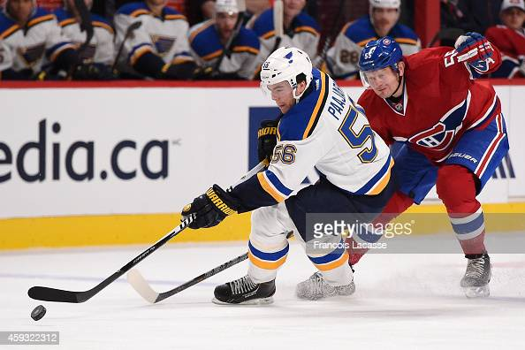 Magnus Paajarvi of the St Louis Blues skates with the puck while being challenged by Sergei Gonchar of the Montreal Canadiens in the NHL game at the...