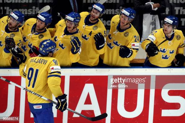 Magnus Paajarvi Svensson of Sweden celebrates his team's first goal with team mates during the IIHF World Championship group E qualification round...