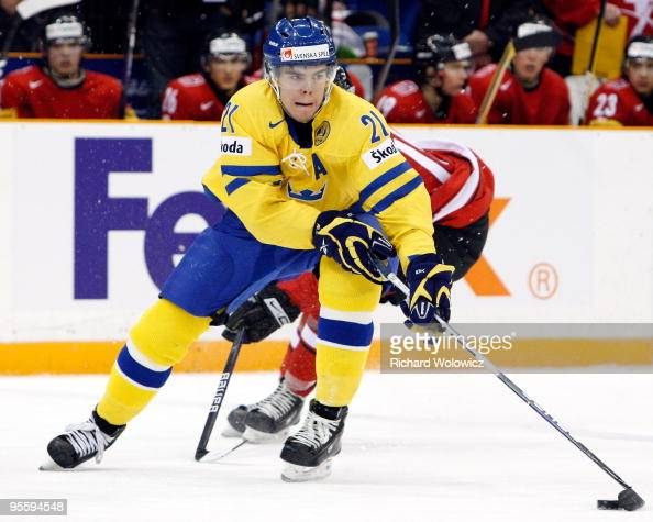 Magnus PaajarviSvensson of Team Sweden skates with the puck while being defended by Jeffrey Fuglister of Team Switzerland during the 2010 IIHF World...