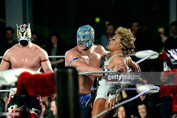 Magnus Puma King and Cassandro El Exotico perform onstage during the EXOTICOS VS LUCHADORES Lucha Libre Show hosted by La Fondation Cartier in Paris...