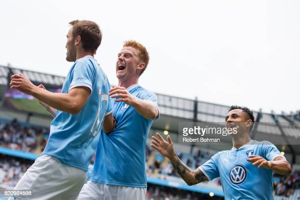 Magnus Wolf Eikrem and Anders Christiansen and Yoshimir Yotún of Malmo FF celebrates after scoring during the Allsvenskan match between Malmo FF and...