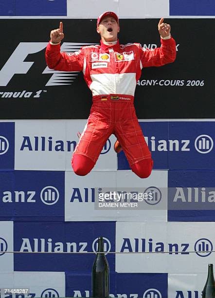 German Ferrari driver Michael Schumacher celebrates on the podium of the Nevers MagnyCours racetrack after the Grand Prix of France 16 July 2006 in...