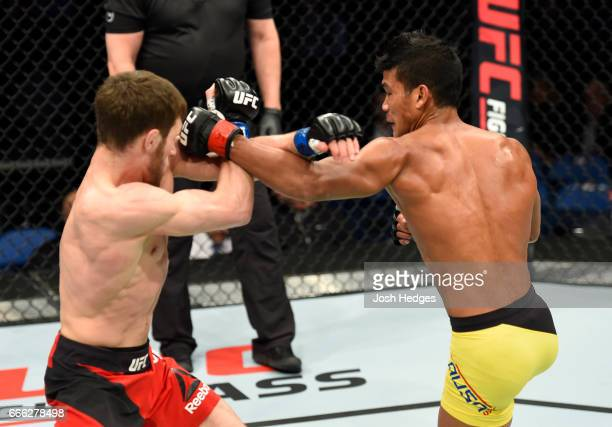 Magomed Bibulatov of Russia fights with Jenel Lausa of the Philippines in their flyweight bout during the UFC 210 event at KeyBank Center on April 8...