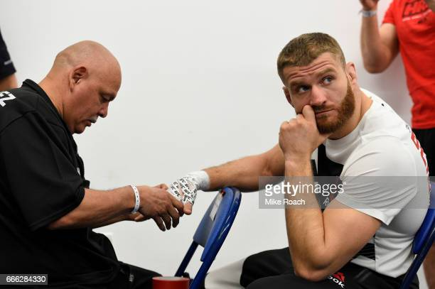 Magomed Bibulatov of Russia has his hand taped prior to his fight against Jenel Lausa of the Philippines at KeyBank Center on April 8 2017 in Buffalo...
