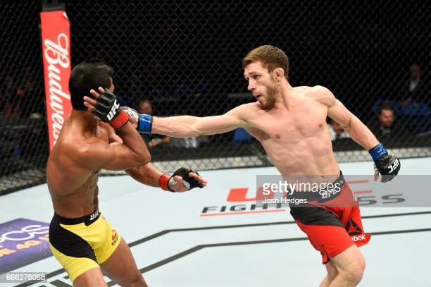 Magomed Bibulatov of Russia lands a punch on Jenel Lausa of the Philippines in their flyweight bout during the UFC 210 event at KeyBank Center on...