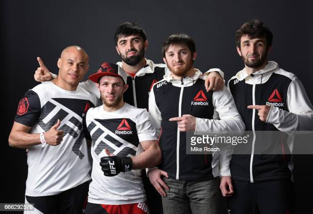 Magomed Bibulatov of Russia poses for a portrait backstage with his team after defeating Jenel Lausa of the Philippines at KeyBank Center on April 8...