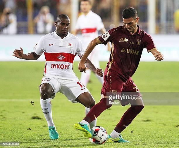 Magomed Ozdoyev of FC Rubin Kazan challenged by Fernando of FC Spartak Moscow during the Russian Premier League match between FC Rubin Kazan and FC...