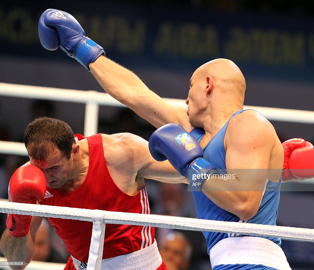 Magomedrasul Medzhidov (red) of Azerbaijan and Ivan Dychko (blue) of Kazakhstan fight during their super 91 kg final at the AIBA World Boxing Championships in Almaty on October 26, 2013. AFP PHOTO / STANISLAV FILIPPOV