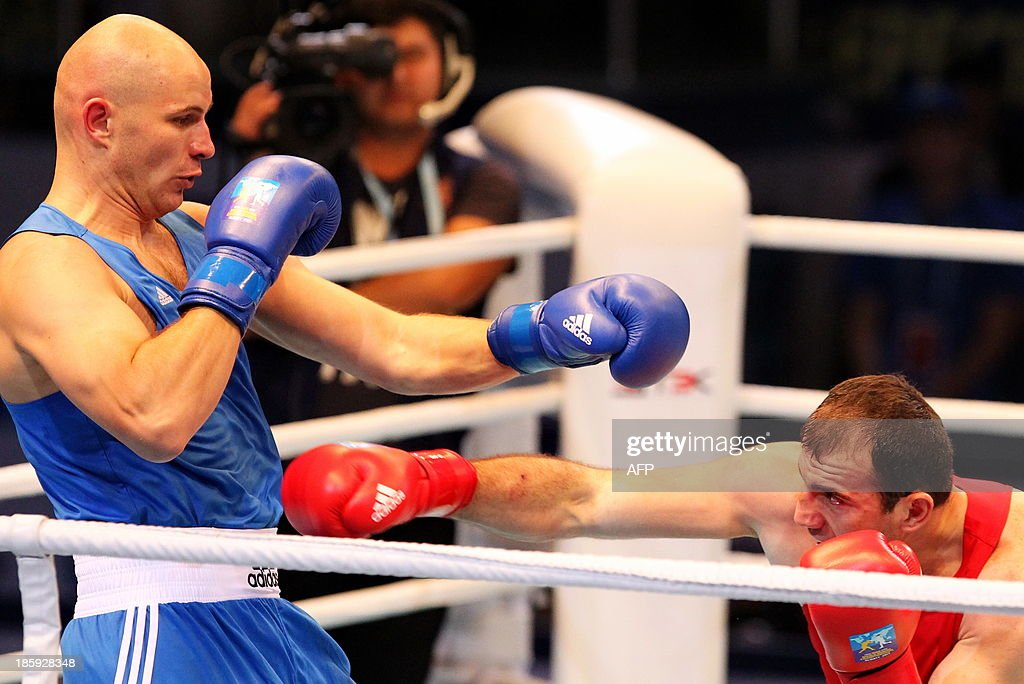 Magomedrasul Medzhidov (red) of Azerbaijan and Ivan Dychko (blue) of Kazakhstan fight during their super 91 kg final at the AIBA World Boxing Championships in Almaty on October 26, 2013.