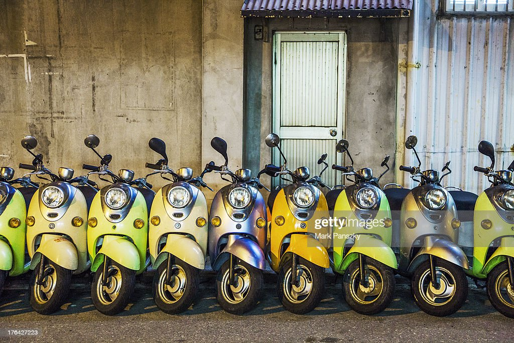 Magong City Penghu Taiwan Scooters in a row waiting for rental