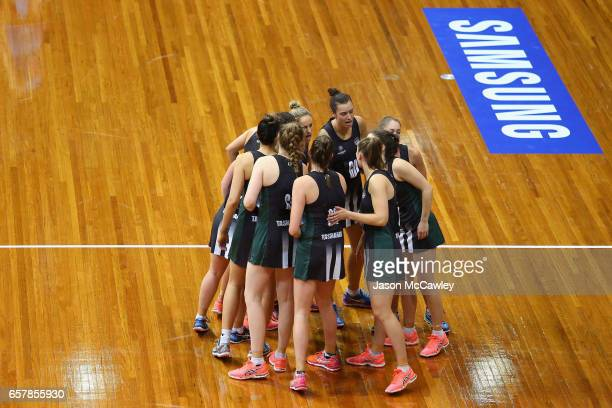 Magpie players form a huddle during the round six ANL match between the Netball NSW Waratahs and the Tasmanian Magpies at Sydney Olympic Park Sports...