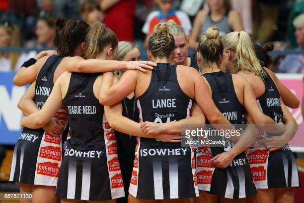 Magpie players form a huddle during the round six Super Netball match between the Swifts and the Magpies at Sydney Olympic Park Sports Centre on...