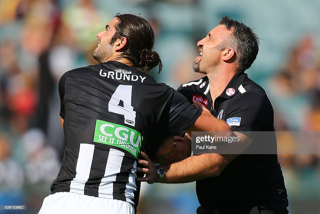 Magpies assistant coach Anthony Rocca and Brodie Grundy of the Magpies work on ruck drills as playes warm up during the round six AFL match between the West Coast Eagles and the Collingwood Magpies at Domain Stadium on May 1, 2016 in Perth, Australia.