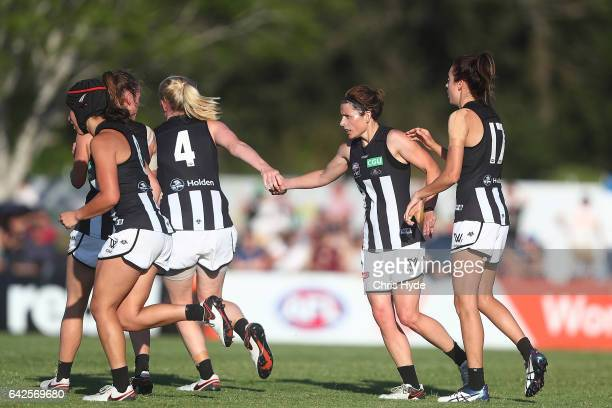Magpies celebrate a goal during the Women's AFL round three match between the Brisbane Lions and the Collingwood Magpies at South Pine Sports Complex...