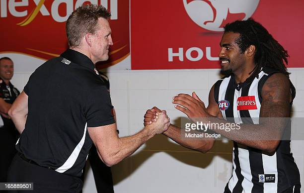 Magpies coach Nathan Buckley celebrates their win with Harry O'Brien during the round two AFL match between the Collingwood Magpies and the Carlton...