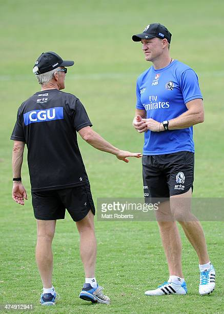 Magpies coach Nathan Buckley speaks with club doctor Peter Bacquie during a Collingwood Magpies AFL training session at the Southport Football Club...
