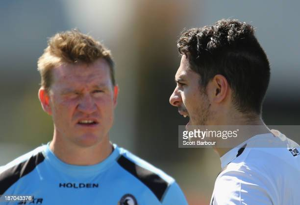 Magpies coach Nathan Buckley speaks with Patrick Karnezis of the Magpies during a Collingwood Magpies AFL training session at Olympic Park on...