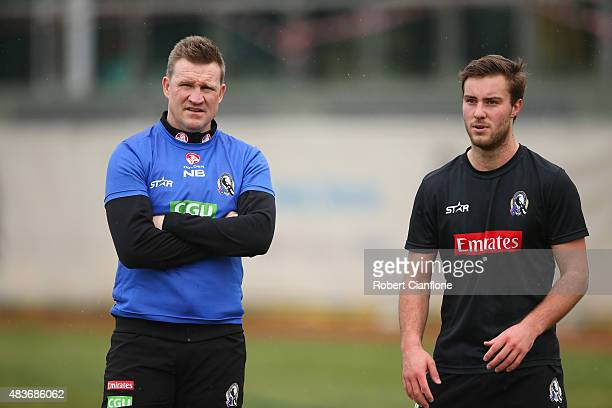Magpies coach Nathan Buckley speaks with Tim Broomhead during a Collingwood Magpies AFL training session at Westpac Lounge Westpac Centre on August...