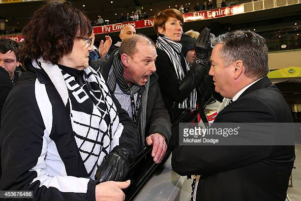 Magpies fan argues with President Eddie Mcguire after their defeat during the round 21 AFL match between the Collingwood Magpies and the Brisbane...