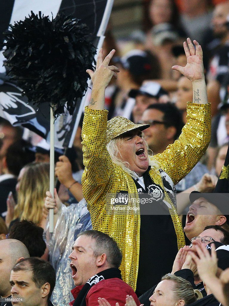 Magpies fan Joffa Corfe wears his gold jacket and celebrates a goal during the round two AFL match between the Collingwood Magpies and the Carlton Blues at Melbourne Cricket Ground on April 7, 2013 in Melbourne, Australia.
