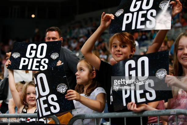 Magpies fans cheer during the round four Super Netball match between the Magpies and the Thunderbirds at Hisense Arena on March 12 2017 in Melbourne...