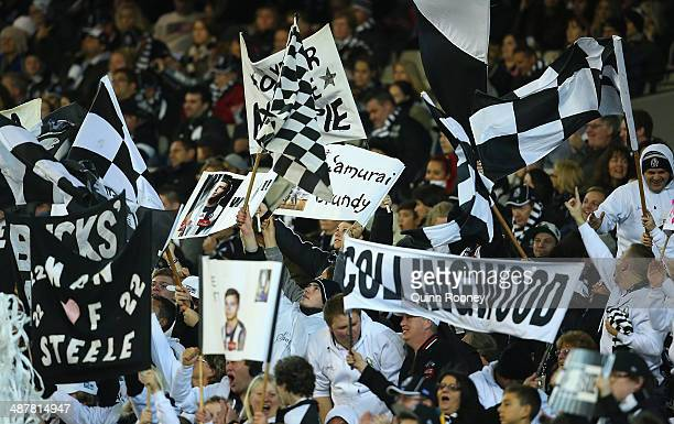 Magpies fans show their support during the round seven AFL match between the Carlton Blues and the Collingwood Magpies at Melbourne Cricket Ground on...