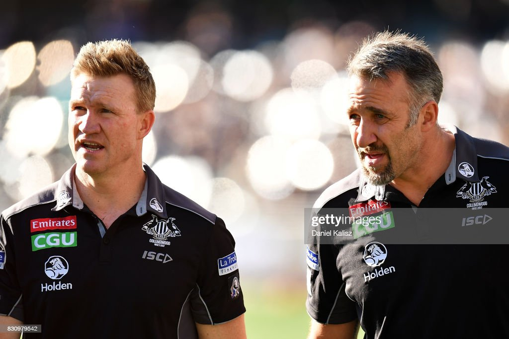 Magpies head coach Nathan Buckley and Anthony Rocca fowards development coach look on during the round 21 AFL match between Port Adelaide Power and the Collingwood Magpies at Adelaide Oval on August 13, 2017 in Adelaide, Australia.