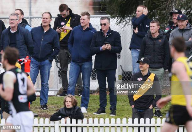 Magpies head coach Nathan Buckley and Magpies President Eddie McGuire look on during the VFL Elimination Final match between the Richmond Tigers and...