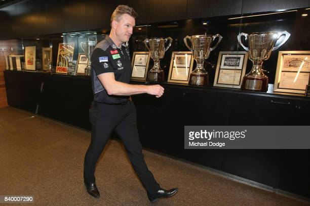Magpies head coach Nathan Buckley arrives during a Collingwood Magpies AFL press conference at the Holden Centre on August 28 2017 in Melbourne...