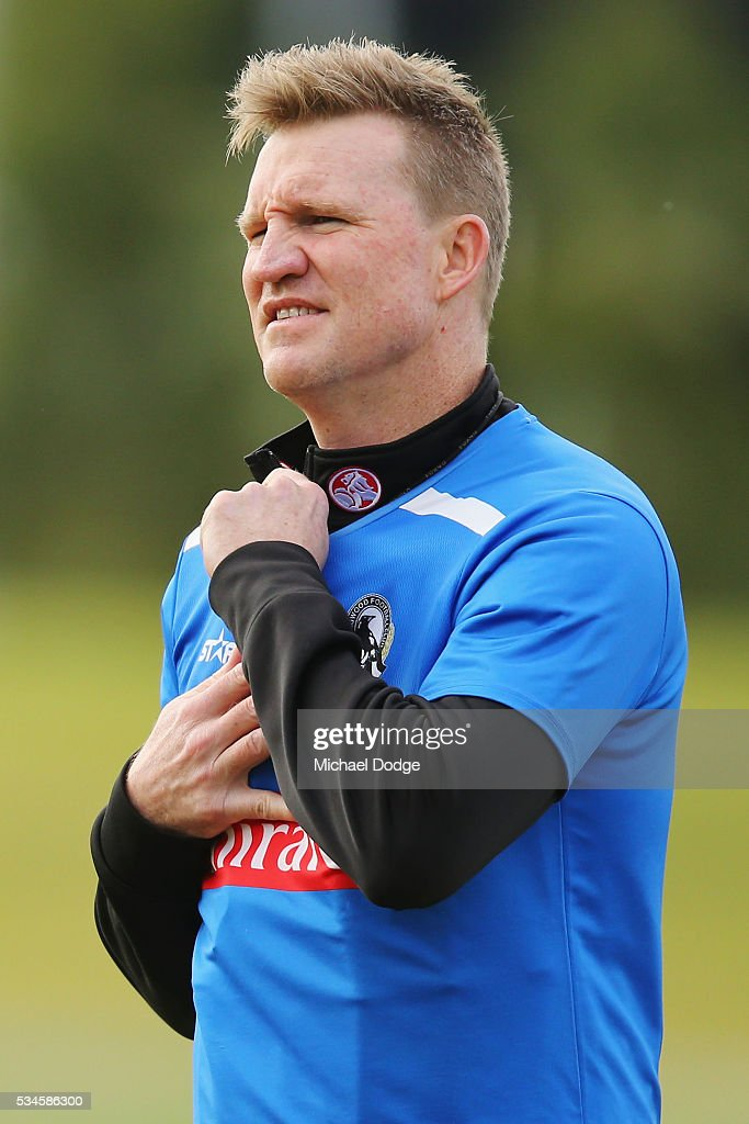 Magpies head coach <a gi-track='captionPersonalityLinkClicked' href=/galleries/search?phrase=Nathan+Buckley&family=editorial&specificpeople=176545 ng-click='$event.stopPropagation()'>Nathan Buckley</a> does up his collar during a Collingwood Magpies AFL training session on May 27, 2016 in Melbourne, Australia.
