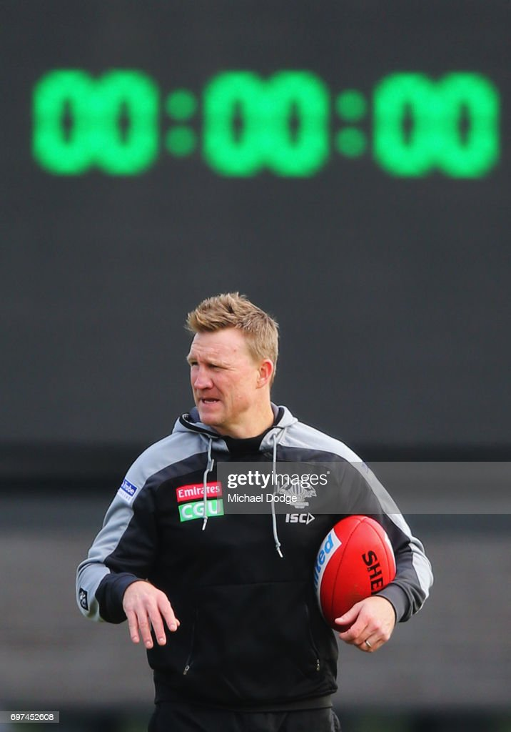 Magpies head coach Nathan Buckley looks upfield with the time clock behind him during a Collingwood Magpies AFL training session at Gosch's Paddock on June 19, 2017 in Melbourne, Australia.