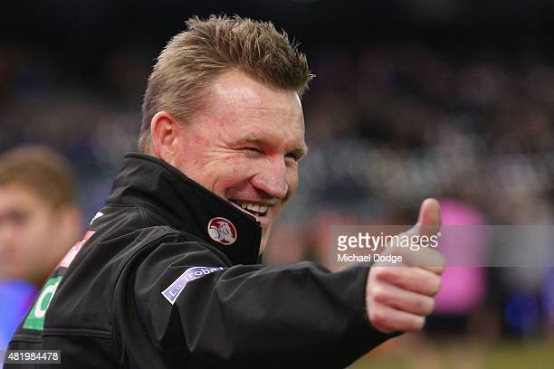 Magpies head coach Nathan Buckley reacts after an interview during the round 17 AFL match between the Western Bulldogs and the Collingwood Magpies at...
