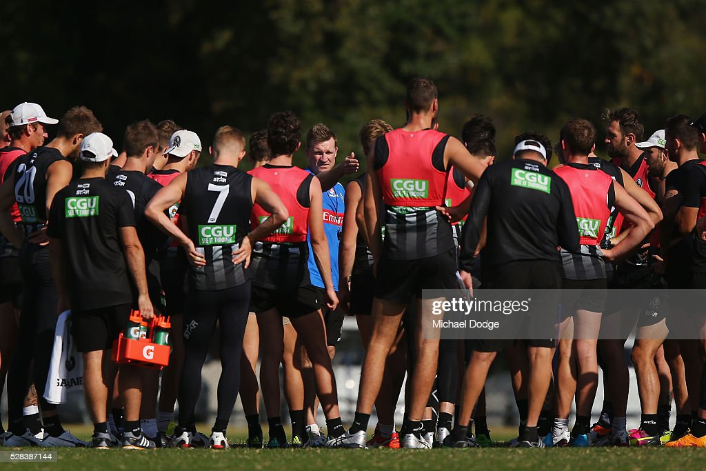 Magpies head coach <a gi-track='captionPersonalityLinkClicked' href=/galleries/search?phrase=Nathan+Buckley&family=editorial&specificpeople=176545 ng-click='$event.stopPropagation()'>Nathan Buckley</a> speaks to his players during a Collingwood Magpies AFL training session on May 5, 2016 in Melbourne, Australia.
