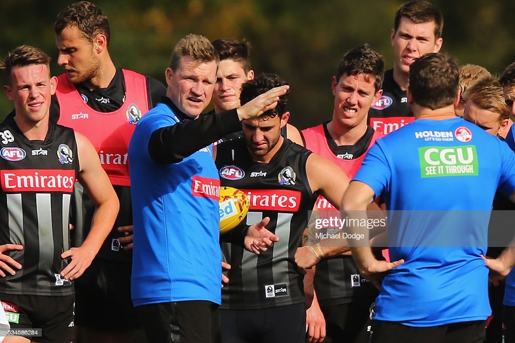 Magpies head coach <a gi-track='captionPersonalityLinkClicked' href=/galleries/search?phrase=Nathan+Buckley&family=editorial&specificpeople=176545 ng-click='$event.stopPropagation()'>Nathan Buckley</a> speaks to his players during a Collingwood Magpies AFL training session on May 27, 2016 in Melbourne, Australia.