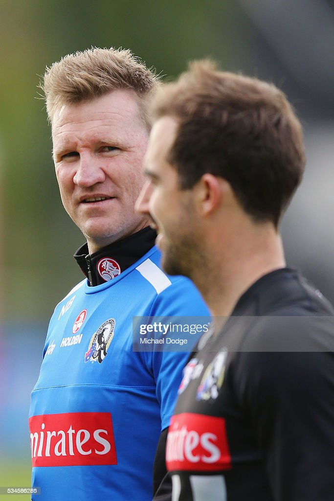 Magpies head coach Nathan Buckley speaks to Steele Sidebottom during a Collingwood Magpies AFL training session on May 27, 2016 in Melbourne, Australia.