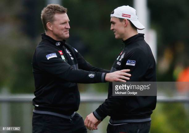 Magpies head coach Nathan Buckley talks to Brayden Maynard during a Collingwood Magpies AFL training session at Gosch's Paddock on July 17 2017 in...