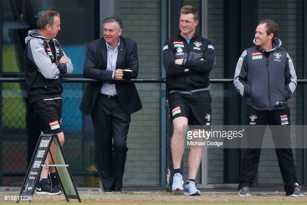 Magpies High Performance Manager Bill Davoren and President Eddie Maguire talk with Magpies head coach Nathan Buckley during a Collingwood Magpies...