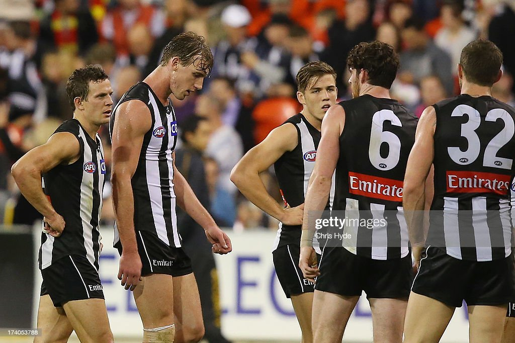 Magpies leave the field at halftime during the round 17 AFL match between the Gold Coast Suns and the Collingwood Magpies at Metricon Stadium on July 20, 2013 in Gold Coast, Australia.